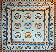 Exclusive quilt patterns by Sue Garman | Come Quilt & It is an 83 by 83 inch quilt is made of nine central blocks, a zig-zag  border with four cornerstones, an outer border with twenty half-blocks and  four ... Adamdwight.com