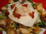 baby frise with poached egg and pancetta