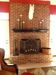 red brick fireplace with white mantel repainted for a cozy feel love eating in front of