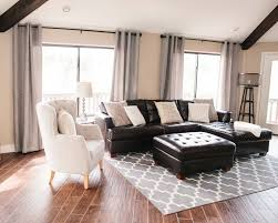 dark furniture living room. Lighten A Room With Dark Furniture And Wood Floors. My Living Room: Leather Couch, Woods Floors, Gray Curtains, White Chevron Rug? N