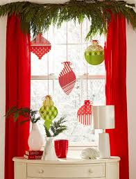 Make some oversized Christmas ornaments from craft paper to make your  window's decor visible from outside