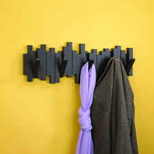 Decorative Wall Coat Racks Umbra Sticks coat rack Love how this folds flat and looks 35