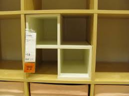 It divides the shelf in 4 and is unbelievably convenient. It has a small  tag that says
