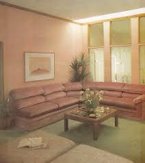 furniture in style. A Glass Topped Coffee Table Here Is In Front Of An Oh-so-80s Dusty Rose Couch. The Living Room Furniture These Magazines Tended Toward That Puffy Style