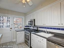 Limestone Kitchen Backsplash Traditional Kitchen With Stone Tile Glass Panel Door In