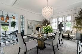 los angeles transitional dining room with semi and faux wainscoting murano glass chandeliers
