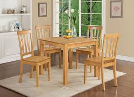 minimalist design for small kitchen table and wooden chairs on grey carpet