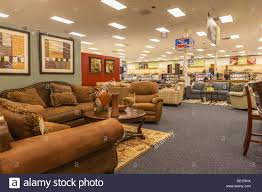 Living room furniture for sale inside the Base Exchange store at