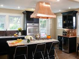 transitional kitchen with black cabinets copper vent hood