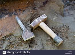 stone hammer and chisel. stock photo - stone masons tools, lump hammer and cold chisel on pennant sandstone t