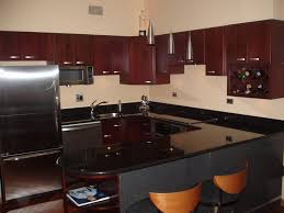 black granite countertops with oak cabinets