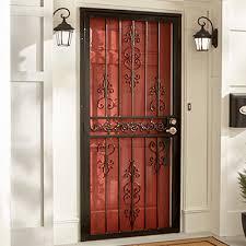 ornate iron security door over a red front door