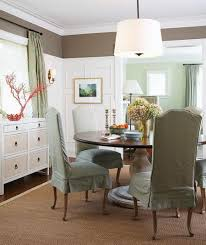 karen cole round dining table green slipcovered dining chairs sisal rug white vintage buffet red c sculpture white pendant light