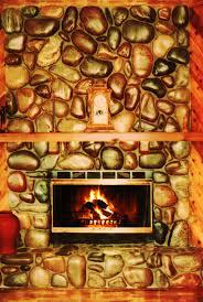 dunbarstonemasonry river rock fireplace sealed with glaze and seal by dunbarstonemasonry