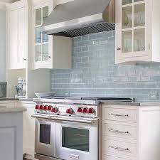 White Kitchen Cabinets with Blue Glazed Subway Tiles