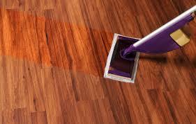 floor being mopped with a swiffer wetjet type modern mop