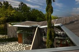 top omer arbel. omer arbelu0027s greenroofed 232 house is framed with sacred reclaimed timber top arbel l