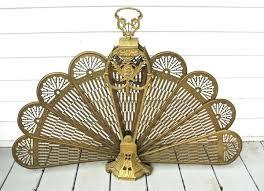 vintage brass peacock folding fan fireplace screen cameo history vintage brass peacock fan sea shell fireplace screen
