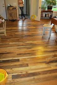 Reclaimed mixed hardwood floor provided by Distinguished Boards + Beams.  2