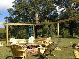5 Swing Fire Pit Remodelaholic Tutorial Build An Amazing Diy Pergola And Firepit