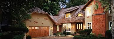 clopay wood carriage house style garage doors on residential home
