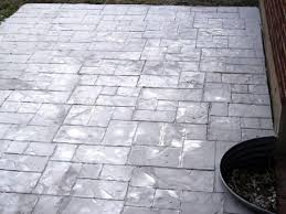enhance an existing patio with concrete