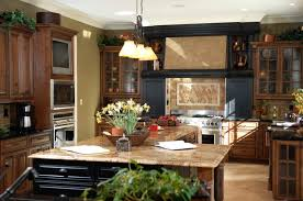 black and stainless kitchen black wood cabinetry surrounds range with beige tile backsplash in this detailed kitchen l