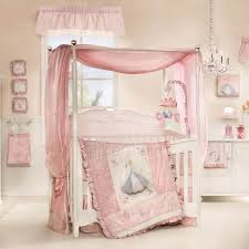 bedroom soft pink bedding set with princess picture also canopy placed on the white wooden