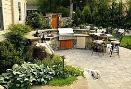 outdoor kitchen with split level and bar patio ideas kitchens grill stations