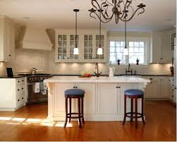 Elegant kitchen photo in New York with glass-front cabinets, beige cabinets  and paneled