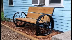 Wagon Wheel Bench in front of house