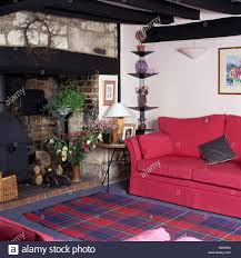 Pink Rugs For Living Room Pink Sofa And Blue Red Tartan Rug In Front Of Inglenook Fireplace