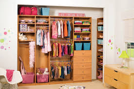 children s closet organizer system in caramel apple laminate