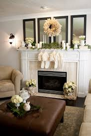 love this mirrors above the mantel cover up the base of the poinsettia with burlap