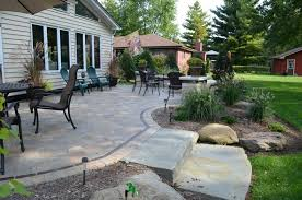 flagstone patio cost 4 reasons to replace your wooden deck with a patio flagstone patio sealant flagstone patio cost