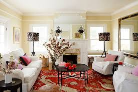 furnitures colorful traditional living room with white sofa and black coffee table on large red