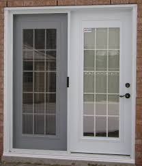 sliding patio doors with blinds between the glass french windows