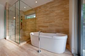 wood look tile wall behind white bath tub and shower