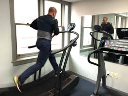 dj took me from machine to machine explaining the technological properties of each one he introduced me to what he calls the ferrari of treadmills