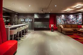 wall collage ideas basement transitional with red seating bar stool brown sofa