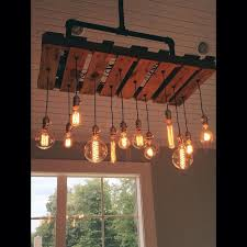 home decorating ideas vintage hand crafted edison bulb chandelier made with reclaimed pallet wood