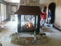 4 sided fireplaces gas modtopiastudio com creating elegant