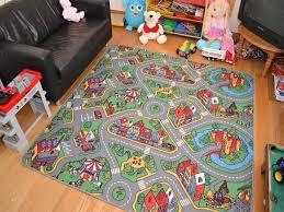 kids play rug with roads