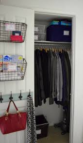 your coat closet is right by your door the purse hooks were another genius idea for this space it s great for keeping purses lunchboxes backpacks
