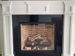 black absolute or absolute black granite fireplace surround and mantle