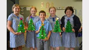 St Joseph's Primary School students making their Christmas craft