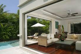 Modern Sunroom Photo hardwood floor ceiling fan by DesignMine