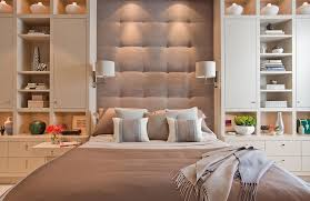 elegant cube ottoman in bedroom contemporary with blue and beige next to brown and cream scheme alongside grey bedding and built in platform beds