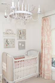 chic pink nursery features a linen upholstered crib restoration hardware baby child belle upholstered crib dressed in pink bedding placed under a