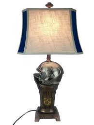 with its antique appearance the dallas cowboys trophy lamp is perfect for the fan that appreciates a vintage look and feel it features a hand painted